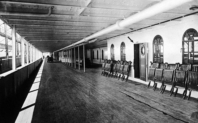 """Original caption: Promenade deck of the ill-fated White Star liner """"Titanic."""" The largest ship in the world in its day, the Titanic sank after hitting an iceberg on its maiden voyage from Southampton, England to New York in 1912 with 2200 people aboard, with a loss of 1513 lives. ca. 1912"""